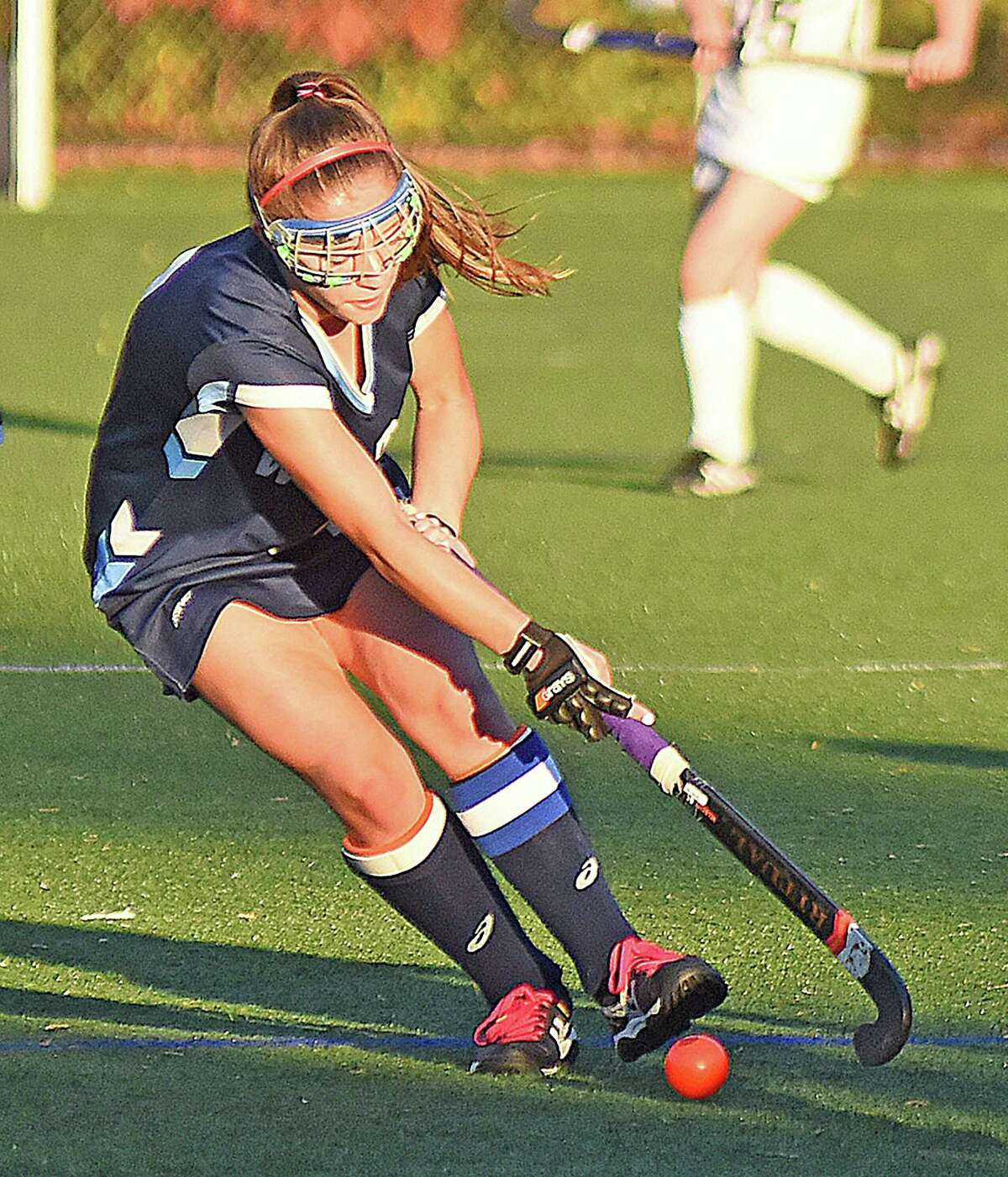 Wilton's Emma Rosen changes direction while pushing the ball up the field during the FCIAC playoffs.