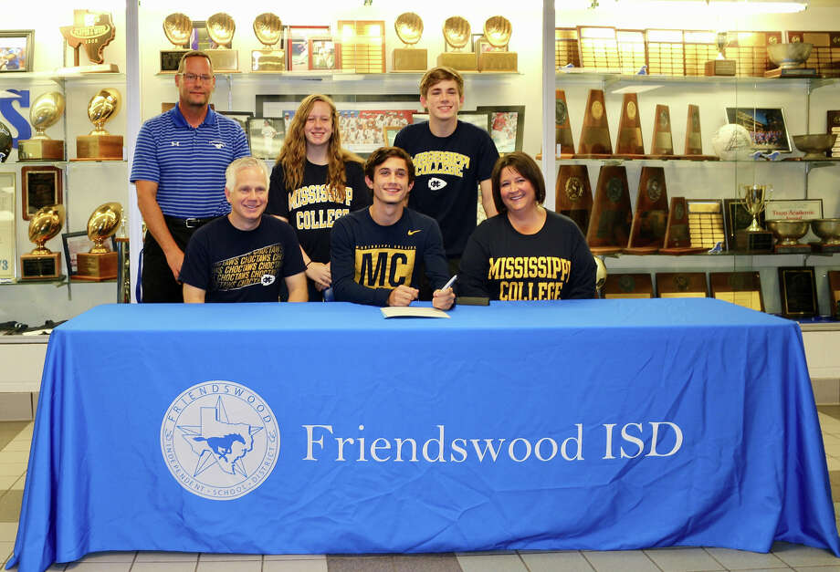Friendswood cross country runner Garrett McGregor has signed a letter of intent with Mississippi College. He is joined at his signing by parents Craig and Cherry, siblings Gracen and Gabriella and FHS coach Steve Hecker. Photo: Courtesy Photo