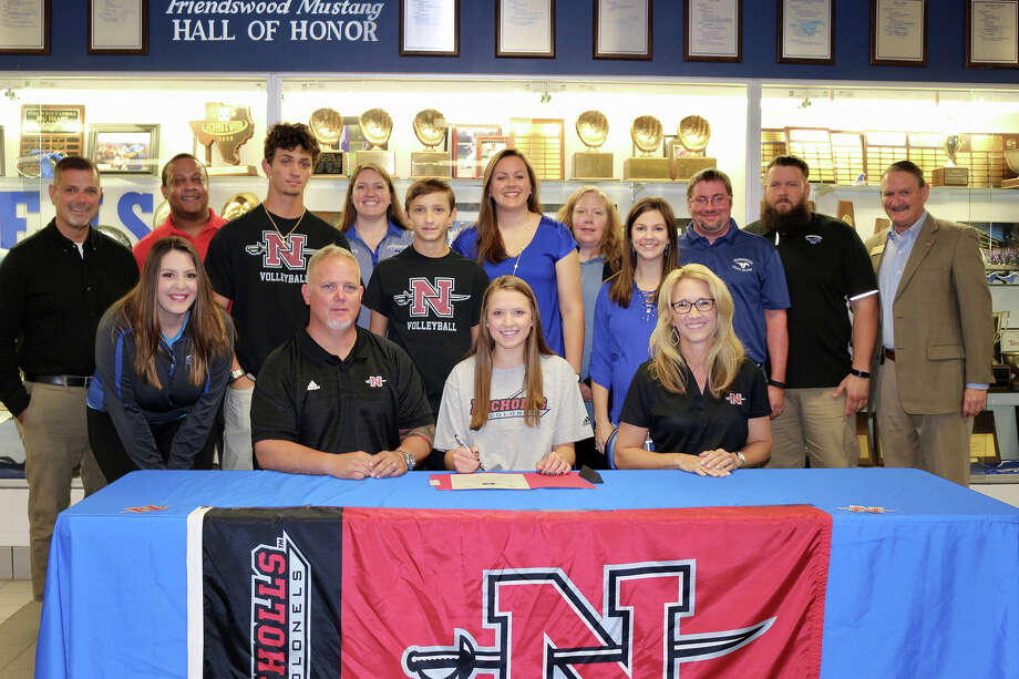 Friendswood volleyball player Kylie Lockhart has signed a national letter of intent with Nicholls State University. Lockhart is shown with her parents, Lael and Nancy, brothers Lael and Kyle, club coach Jerry Linch, trainers Megan Duncan, Jonathan Utsey and Chris Grasty, FHS coaches Sarah Paulk, Shayna Sauers and Kristin Goodman and FHS principal Mark Griffon. Photo: Courtesy Photo