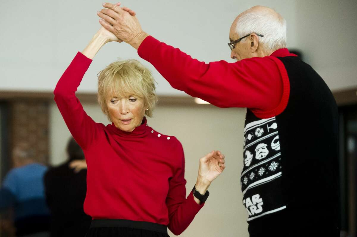 People dance to Christmas songs played by Blast from the Past, Midland's oldest continuous operating big band, during a dance held on Monday, Dec. 5, 2017 at the Greater Midland Community Center. Blast from the Past will perform more Christmas songs at the Grace A. Dow Memorial Library on Sunday, Dec. 10 at 2:30 p.m. Admission is free. (Katy Kildee/kkildee@mdn.net)