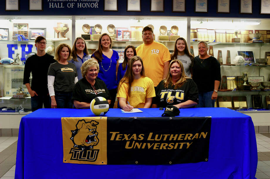 Friendswood volleyball player Madison Weisinger has signed a national letter of intent with Texas Lutheran University. Weisinger was joined at the signing by parents, Randy and Tammy, sister Mckenna, Mona Ray Dudley, Claire Dudley, Jane Mitchell and FHS coaches Sarah Paulk, Shayna Sauers and Kristin Goodman. Photo: Courtesy Photo