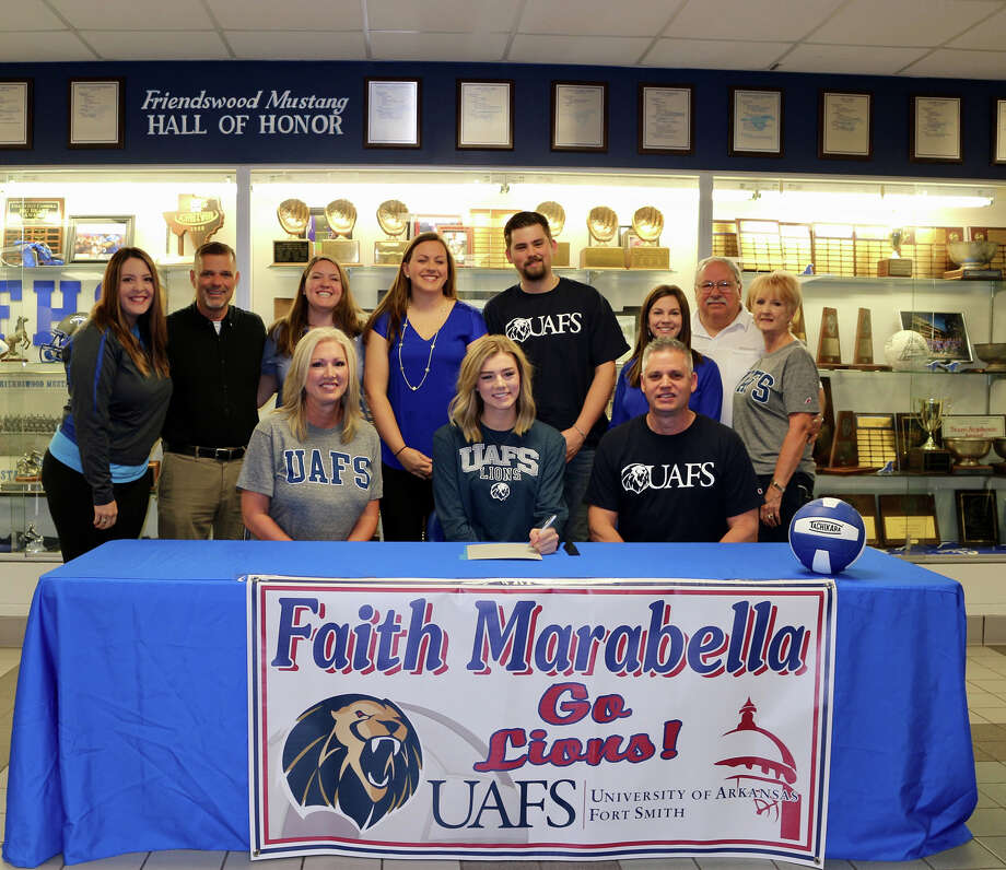 Friendswood volleyball player Faith Marabella has signed a national letter of intent with the University of Arkansas-Fort Smith. Marabella is shown with parents Jeff and Stephanie, brother Berkley, grandparents Mike and Sue Armstrong, club coaches Jerry Linch and Lauren Ellison and FHS coaches Sarah Paulk, Shayna Sauers and Kristin Goodman. Photo: Courtesy Photo