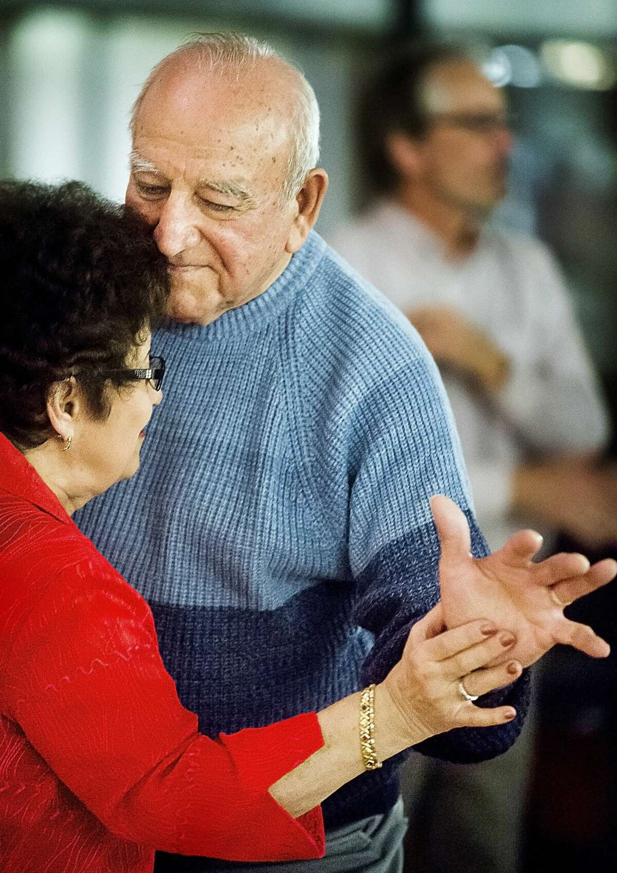 Manuel Sanchez of Saginaw, center, dances with Fran Gay of Flint as Blast from the Past, Midland's oldest continuous operating big band, plays Christmas songs during a dance held on Monday, Dec. 5, 2017 at the Greater Midland Community Center. Blast from the Past will perform more Christmas songs at the Grace A. Dow Memorial Library on Sunday, Dec. 10 at 2:30 p.m. Admission is free. (Katy Kildee/kkildee@mdn.net)