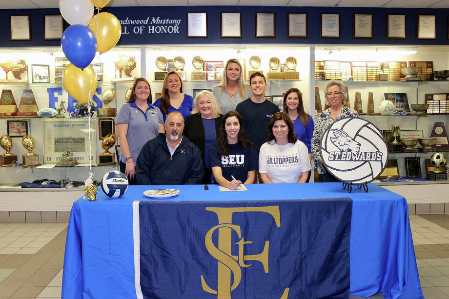 Natalie Abowd of Friendswood High School has signed a national volleyball letter of intent with St. Edwards University. Abowd is joined by parents Matt and Michelle Abowd, brother Nick, grandmother Margo Clements, aunt Alice Rogers, coaches Suzy Buechele and Nancy Cole and Friendswood coaches Sarah Paulk, Shayna Sauers and Kristin Goodman. Photo: Courtesy Photo