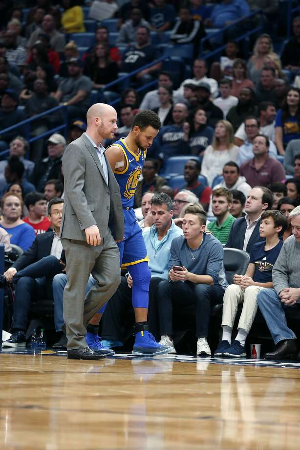 Golden State Warriors guard Stephen Curry limps off the court to the locker room in the second half of an NBA basketball game against the New Orleans Pelicans in New Orleans, Monday, Dec. 4, 2017. The Warriors won 125-115. (AP Photo/Gerald Herbert) Photo: Gerald Herbert, Associated Press