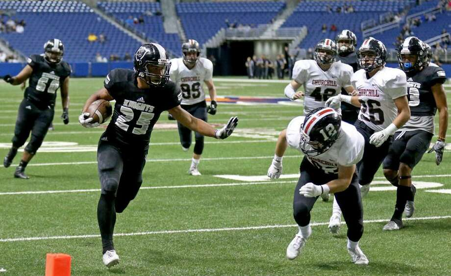 Steele's Brenden Brady heads to the end zone for a touchdown around Churchill's Thomas Sharrick during first half action of their Class 6A Division II state quarterfinal playoff game on Dec. 3, 2016 at the Alamodome. Photo: Edward A. Ornelas /Express-News