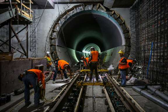 Workers do construction on the central subway at the Moscone station in San Francisco, Calif., on Wednesday, Sept. 13, 2017.