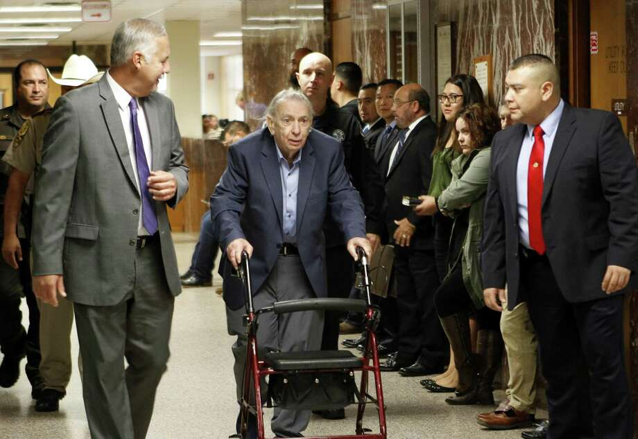 Former priest, John Feit walks down the hallway to the 92nd state District Court for the fourth day of his trial, Tuesday, Dec. 5, 2017, at the Hidalgo County Courthouse in Edinburg, Texas. Feit is accused of suffocating Irene Garza in April 1960 after she went to confession at Sacred Heart Catholic Church in McAllen. (Nathan Lambrecht /The Monitor via AP) Photo: Nathan Lambrecht, MBI / Associated Press / The Monitor