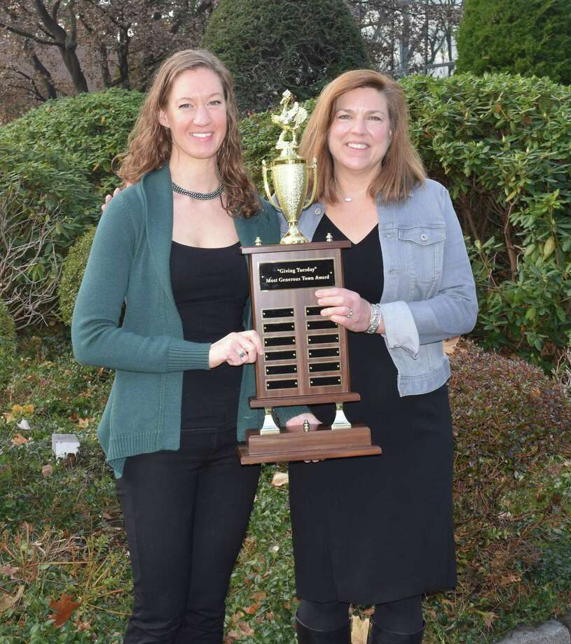 "Lauren Patterson (left) of the New Canaan Community Foundation and Carrie Bernier of the Community Fund of Darien with the trophy for the ""most generous town"" competition. The Community Fund of Darien in Darien, Conn. won the compeition, held on Giving Tuesday on Nov. 28, 2017 Photo: Contributed Photo / Contributed Photo / New Canaan News contributed"