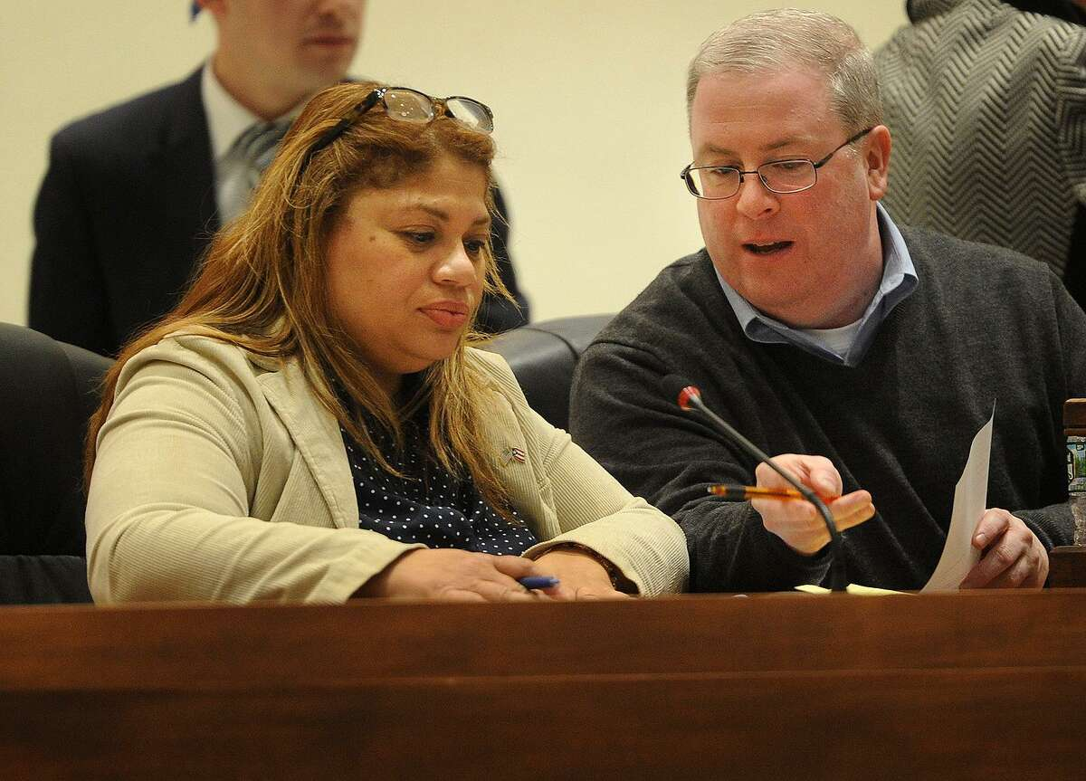 Newly-elected Bridgeport City Coucil President Aidee Nieves sits with outgoing Council President Thomas McCarthy during the City Council meeting at City Hall in Bridgeport, Conn. on Monday, December 4, 2017.