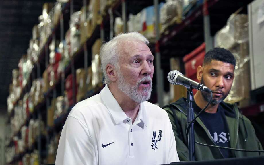 Retired Spurs superstar Tim Duncan listened as Coach Gregg Popovich spoke of the need for those who have much to give to those who have little. Duncan, following that advice in a big way, donated $500,000 in a matching challenge to feed hungry families in San Antonio during the holiday season. Photo: Ron Cortes /For The San Antonio Express-News