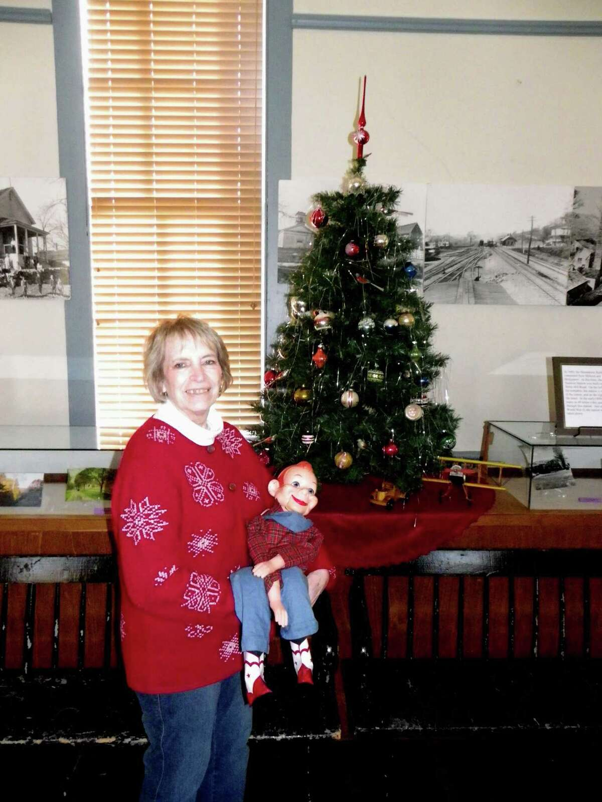 Barbara Golde, exhibit director for the Brookfield Historical Society, holds up a vintage Howdy Doody Puppet, one of the many classic dolls, toys and other items reminiscent of Christmases gone by that will be on display at the Brookfield Museum's seventh annual Traditional Christmas Open House