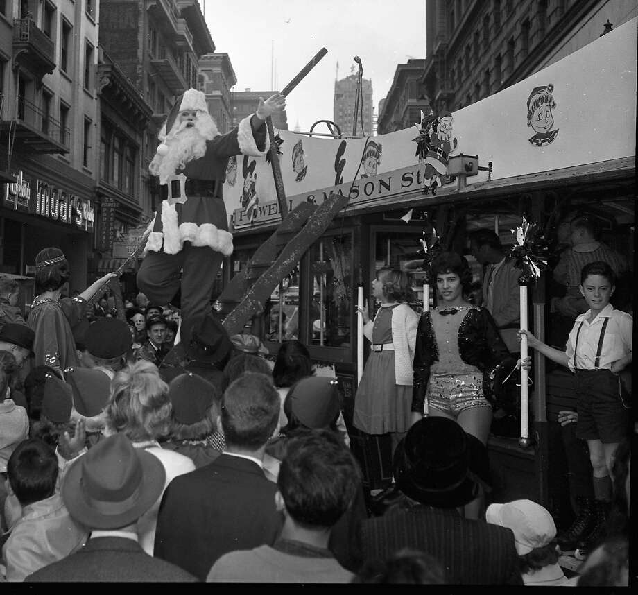 Santas at various downtown San Francisco Department stores, December 18, 1966. An elaborate parade down Market Street always culminated in Santa arriving at the Emporium by cable car. Photo: Photographer Unknown, The Chronicle