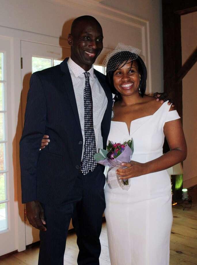 Reginald Sealey (left) and Erica Fray of Stamford, Conn. got married at the Darien Historical Society in Darien, Conn. on Nov. 30, 2017. Photo: Erin Kayata / Hearst Connecticut Media / Darien News
