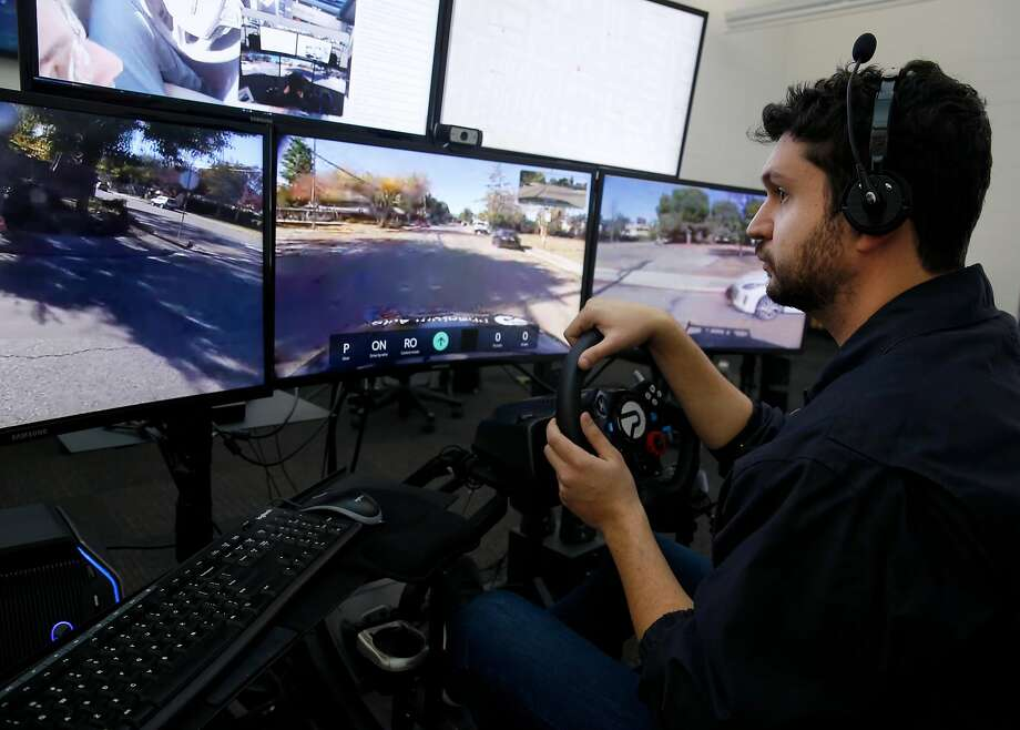 Ben Shukman drives an autonomous vehicle remotely at Phantom Auto's labs in Mountain View. The company is developing centers from which human operators can take control of robot cars if necessary. Photo: Paul Chinn, The Chronicle