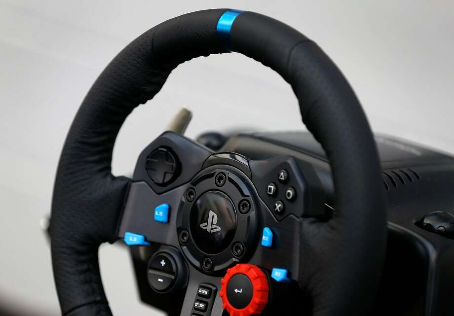 A video-game-style steering wheel allows a Phantom teleoperator to drive a car. Photo: Paul Chinn, The Chronicle