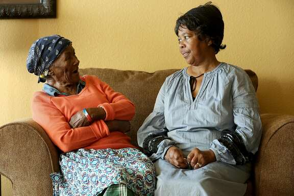 Eula Sims (left), 88 years old, talks with her daughter Delores Stringer (right) in the community library where Eula lives on Wednesday, November 29, 2017, in Richmond, Calif.