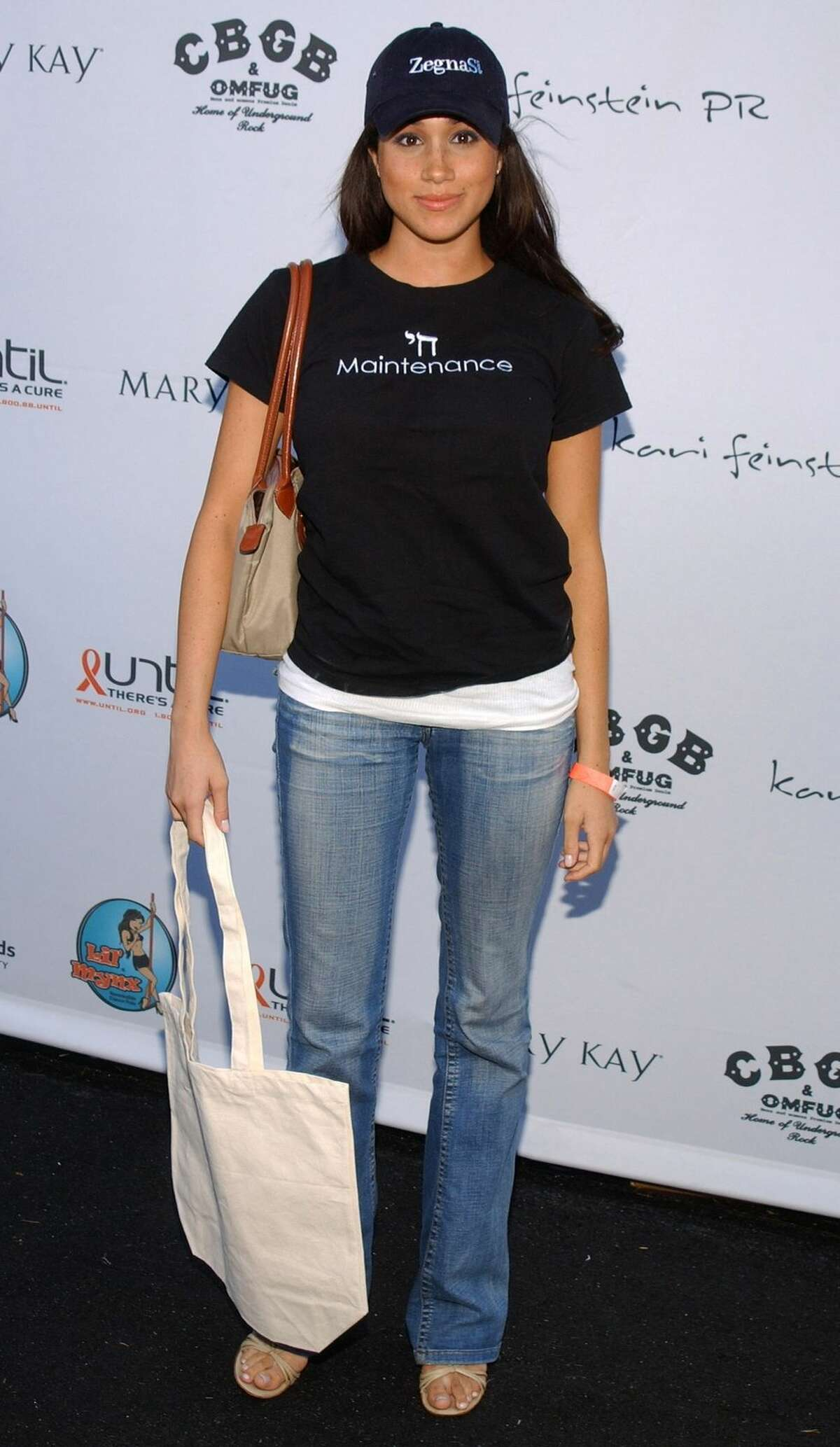 Meghan Markle Grabbing swag at the pre-Emmy Style Lounge in 2005.