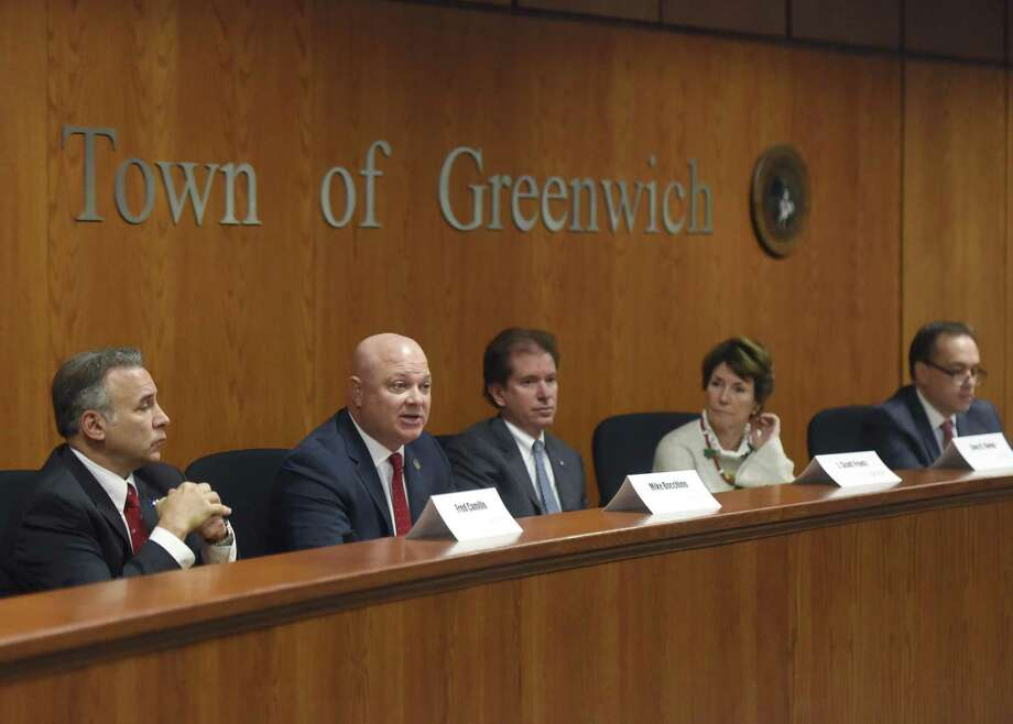 State Rep. Mike Bocchino, second from left, speaks beside State Rep. Fred Camillo, left, State Sen. Scott Frantz, center, State Rep. Livvy Floren and First Selectman Peter Tesei at the Greenwich United Way legislative breakfast at Town Hall in Greenwich, Conn. Tuesday, Dec. 5, 2017. First Selectman Peter Tesei joined state Sen. Scott Frantz and Reps. Livvy Floren, Mike Bocchino and Fred Camillo to answer questions about poverty, opiods and other issues. Photo: Tyler Sizemore / Hearst Connecticut Media / Greenwich Time