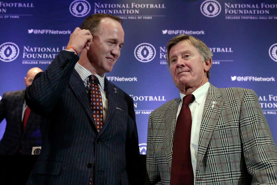 CORRECTS SPELLING TO PEYTON, NOT PAYTON - Former University of Tennessee football quarterback Peyton Manning, left, and former University of Florida football quarterback Steve Spurrier get together after a news conference of the National Football Foundation and College Football Hall of Fame, in New York, Tuesday, Dec. 5, 2017. (AP Photo/Richard Drew) Photo: Richard Drew, Associated Press / AP