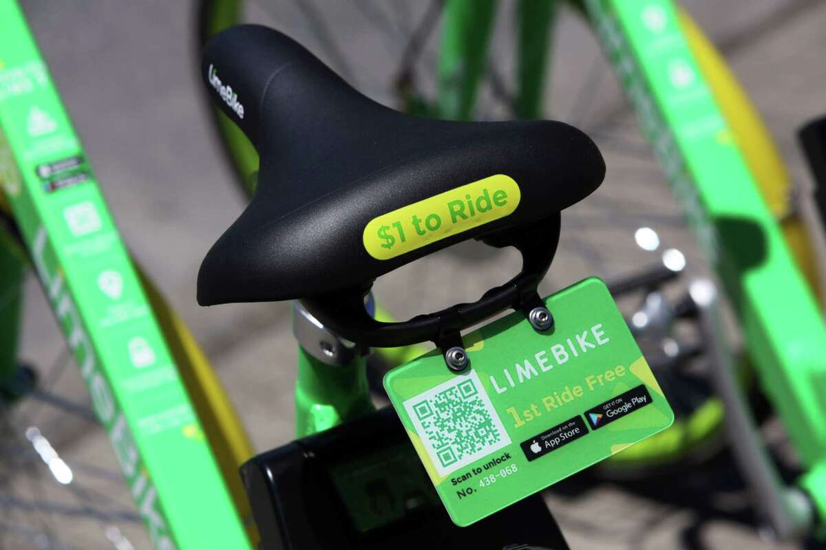 Bikes, such as this LimeBike seen in Seattle, are unlocked via an app and do not come with helmets.