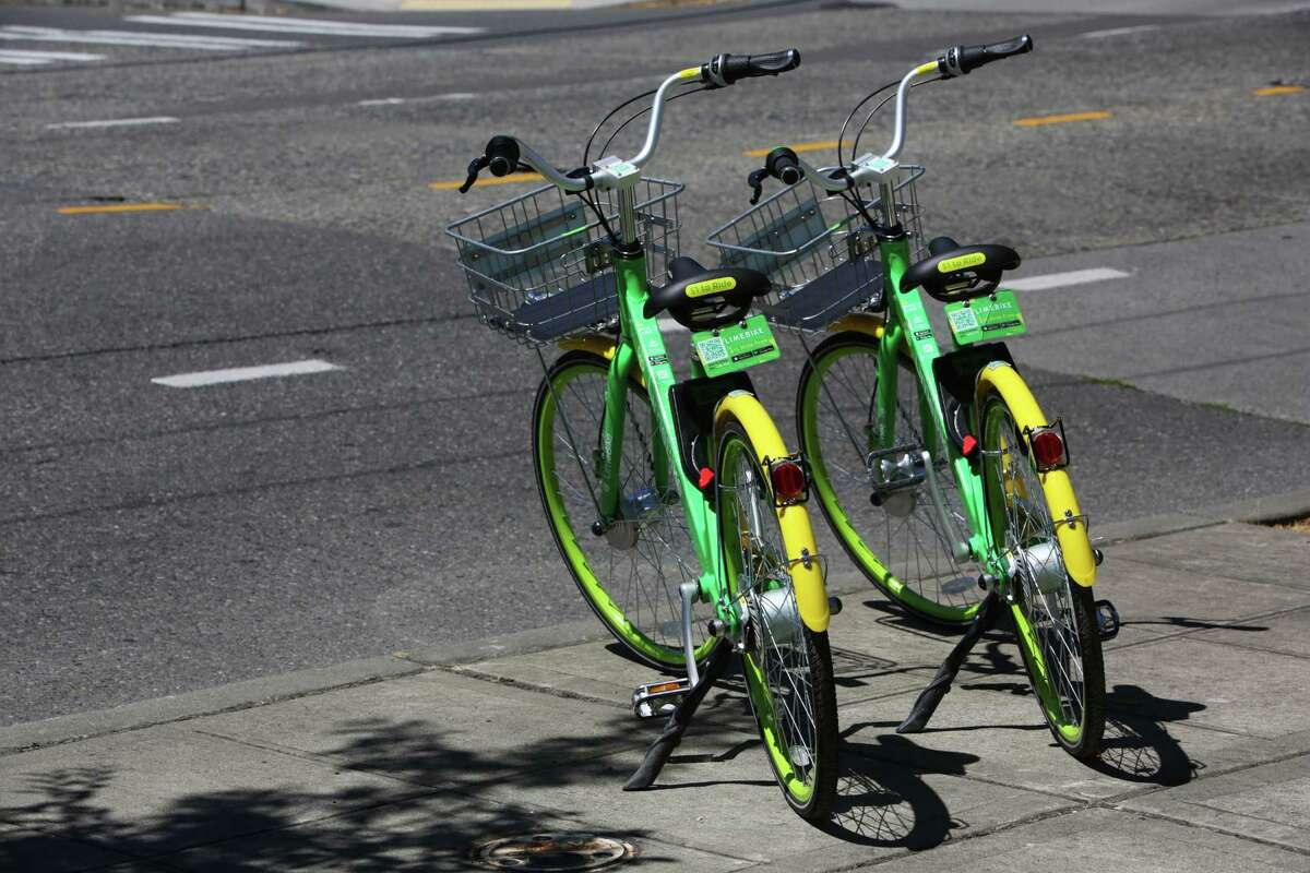 LimeBike, one of a handful of dockless bike companies interesting in distributing bikes around Houston, like these two in Seatlle's lower Queen Anne neighborhood on July 26, 2017. Bikes are unlocked via an app and do not come with helmets.