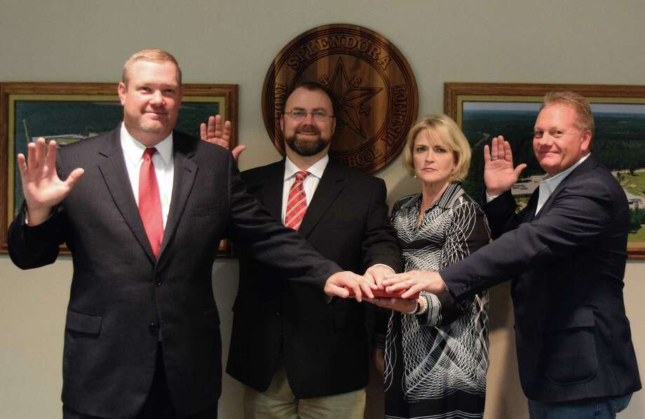 New Splendora ISD board members Adam Dietrich and Barry Welch, and incumbent trustee Dan Muirhead were sworn into new terms at the start of the Dec. 4 board meeting. Holding the Bible is Deitre Inkster, spokesperson for Splendora ISD and notary public. Photo: Submitted