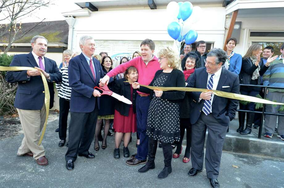 STAR Inc.Executive Director Katie Banzhaf gets help from Participants Todd McInerney and Nicki Dubiago, New Canaan First Selectman Kevin Moynahan and former First Selectman Rob Mallozzi as they cut the ribbon to open the new space for STAR Inc. in downtown New Canaan Conn. on Monday December 4, 2017 STAR, Inc., is a Norwalk-based non-profit that supports people with intellectual and developmental disabilities Photo: Alex Von Kleydorff / Hearst Connecticut Media / Norwalk Hour