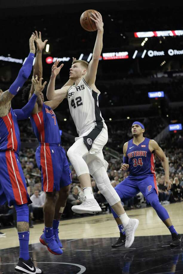 San Antonio Spurs forward Davis Bertans (42) drives to the basket against Detroit Pistons forward Stanley Johnson (7) during the second half of an NBA basketball game, Monday, Dec. 4, 2017, in San Antonio. San Antonio won 96-93. (AP Photo/Eric Gay) Photo: Eric Gay, STF / Associated Press / Copyright 2017 The Associated Press. All rights reserved.