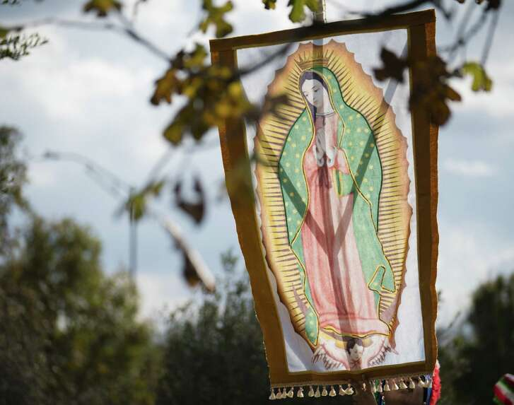 A banner of the Virgen de Guadalupe is seen in a procession of Matachine dancers during a celebration of the Feast Day of the Immaculate Conception, Dec. 3 at Mission Concepcion in San Antonio.