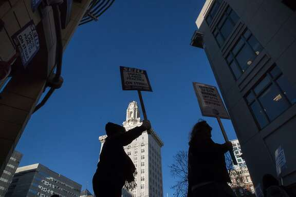 Striking civilian labor unions which represent approximately 2,700 employees at Frank Ogawa Plaza on Tuesday, Dec. 5, 2017 in Oakland, CA.