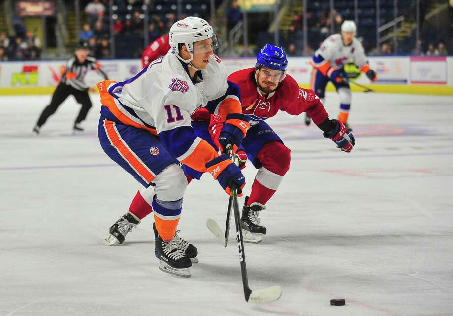 Tanner Fritz (11) of the Sound Tigers gets an assist during a game against Laval on Oct. 21 in Bridgeport. Photo: Gregory Vasil / For Hearst Connecticut Media / Connecticut Post Freelance