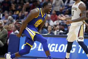 Golden State Warriors forward Draymond Green (23) reacts after making a 3-point basket in the second half of an NBA basketball game against the New Orleans Pelicans in New Orleans, Monday, Dec. 4, 2017. (AP Photo/Gerald Herbert)