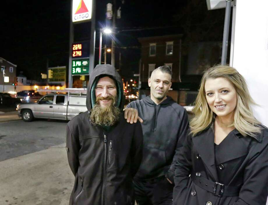 Kate McClure and her boyfriend, Mark D'Amico, center, set up a GoFundMe page for Johnny Bobbit, a homeless veteran who help her get gas one night. Photo: Elizabeth Robertson, MBI / PHILADELPHIA INQUIRER
