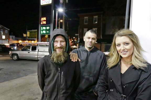 Kate McClure and her boyfriend, Mark D'Amico, center, set up a GoFundMe page for Johnny Bobbit, a homeless veteran who help her get gas one night.