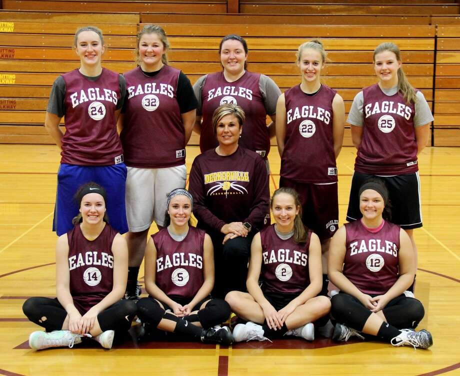 p.p1 {margin: 0.0px 0.0px 0.0px 0.0px; line-height: 10.8px; font: 10.0px Helvetica}Members of the Deckerville girls basketball team are (from row from left) Emma Morningstar, Madisyn Guza, assistant coach Amy Foote, Kylee Colesa, Liz Binder, (back row) Charlotte Schulz, Haileigh Foote, Kaylynn Schtz, Morgan Armstead and Julia Flanagan. Missing is head coach Pat Oswald. (Chip Burch/Huron Daily Tribune) Photo: Chip Burch/Huron Daily Tribune