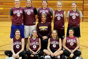 p.p1 {margin: 0.0px 0.0px 0.0px 0.0px; line-height: 10.8px; font: 10.0px Helvetica}  Members of the Deckerville girls basketball team are (from row from left) Emma Morningstar, Madisyn Guza, assistant coach Amy Foote, Kylee Colesa, Liz Binder, (back row) Charlotte Schulz, Haileigh Foote, Kaylynn Schtz, Morgan Armstead and Julia Flanagan. Missing is head coach Pat Oswald. (Chip Burch/Huron Daily Tribune)