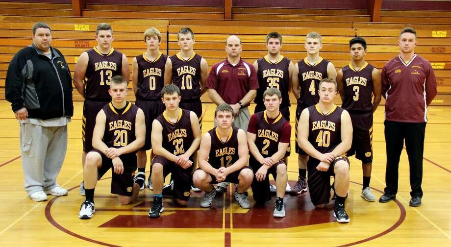 Members of the Deckerville boys basketball team are (from row from left) Jeff Stone, Brendan Kreiner, Chayse Pattulo, Kenton Bowerman, Curtis Vogel, (back row), assistant coach Ron Webb, Wyatt Janowiak, Luke Asher, Zachary Ostrowski, Coach Tim Brabrant, Richard Barker, Cole Romzek and assistant coach Ken Dupure. (Chip Burch/Huron Daily Tribune) Photo: Chip Burch/Huron Daily Tribune