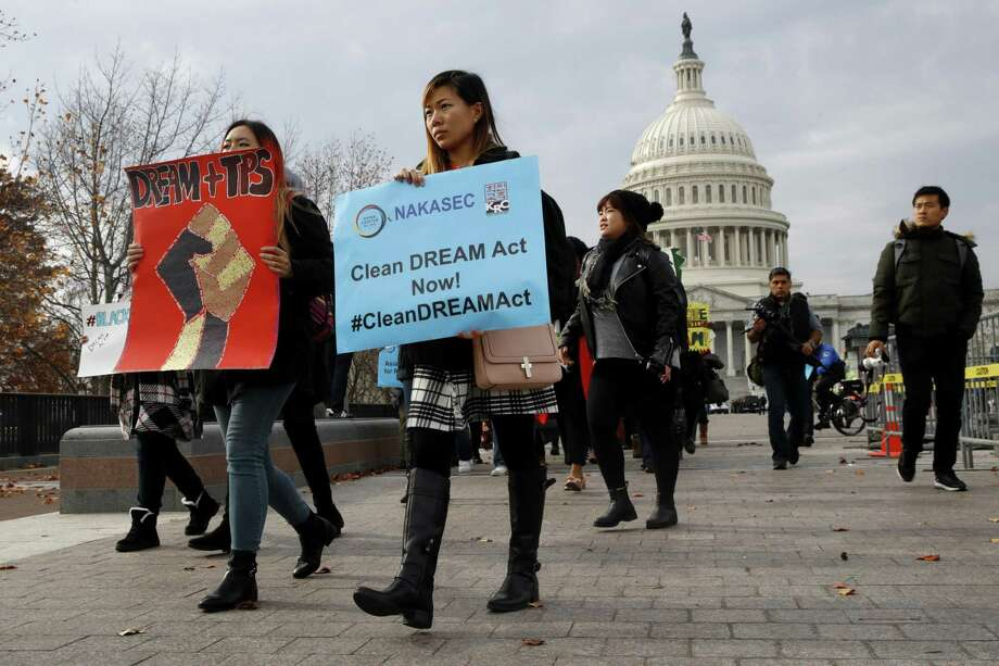 People march by the Capitol in support of the Deferred Action for Childhood Arrivals (DACA), and Temporary Protected Status (TPS), programs Tuesday, Dec. 5, 2017, on Capitol Hill in Washington. (AP Photo/Jacquelyn Martin) Photo: Jacquelyn Martin, STF / Associated Press / Copyright 2017 The Associated Press. All rights reserved.