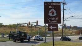 A sign points to the original route for the Camino Real at Nacogdoches and Naco Perrin in North San Antonio.