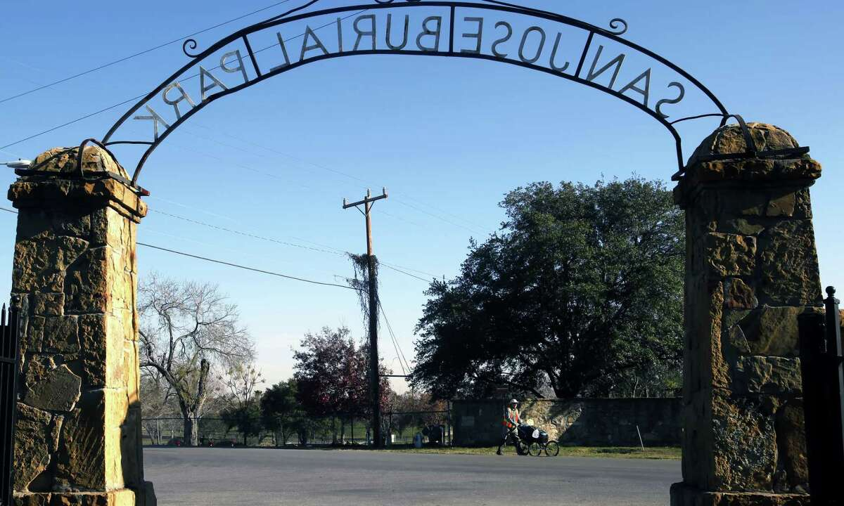 Framed by an entrance ot San Jose Burial Park, Bart Smith walks Jan. 4, 2012, along the Mission Trail; part of the larger El Camino Real that runs from Natchitoches, La., to Eagle Pass. Smith said he has walked every major through-hike in the country, including the Pacific Crest and Appalachian trails, and was expanding to historic trails.