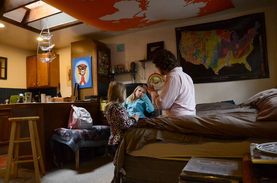TC Bell sits with daughters Dagny, 8, and Emma, 4, at their home in Denver. The girls are recipients of the Children's Health Insurance Program, or CHIP. Photo: Tatiana Flowers, Associated Press