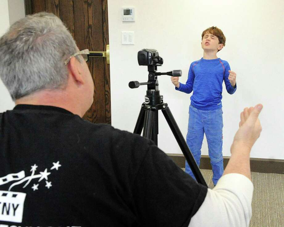 Charlie Maniaci, 7, of Greenwich, takes part in the Greenwich Performing Arts Studio video audition with Todd Etelson, left, of Actors Technique New York at the First Congregational Church in Old Greenwich, Conn., Saturday, Dec. 2, 2017. Etelson is a  NYC kids and teen acting coach. The video audutions will be used in a New York City movie night attended by agents, managers and casting directors. Photo: Bob Luckey Jr. / Hearst Connecticut Media / Greenwich Time