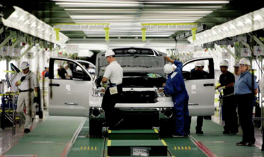 Toyota workers produce Tundra pickup trucks in San Antonio at its assembly plant. The plant is one of 1,544 manufacturing companies, which had a $40.5 billion economic impact on the local economy, according to a new report Tuesday. Photo: Eric Gay /AP / AP