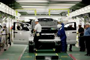 Toyota workers produce Tundra pickup trucks in San Antonio at its assembly plant. The plant is one of 1,544 manufacturing companies, which had a $40.5 billion economic impact on the local economy, according to a new report Tuesday.