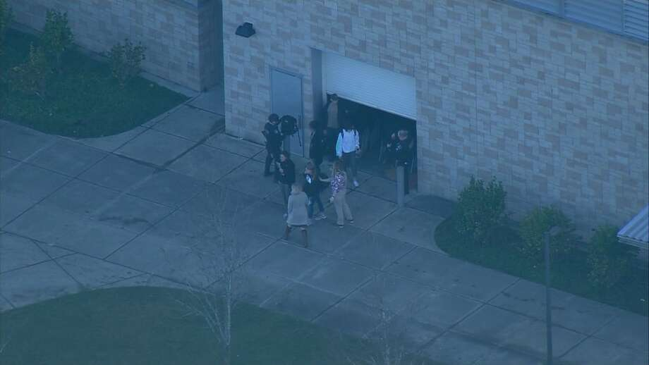 Students and officers are seen outside Graham-Kapowsin High School after a shooter injured two students Dec. 5, 2017.A 16-year-old student, Ronald Ackerson, was arrested Monday and charged Tuesday as the suspected shooter. Photo: KOMO News