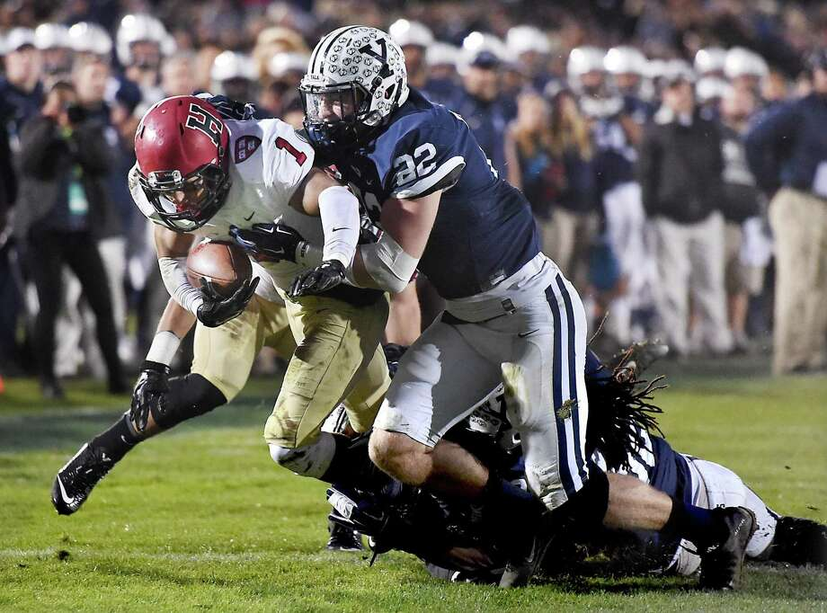 Yale's Matthew Oplinger, seen here during a game against Harvard in 2015, was named the Ivy League's defensive MVP on Tuesday. Photo: Catherine Avalone / Heart Connecticut Media / Catherine Avalone/New Haven Register