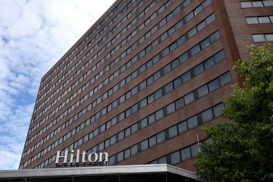 Exterior of the Hilton Hotel on Friday, Oct. 13, 2017, in Albany, N.Y. The union that represents employees at the Hilton Albany is pressing for a requirement in a new labor contract that panic buttons be distributed to hotel staff. (Will Waldron/Times Union archive) Photo: Will Waldron / 20041846A