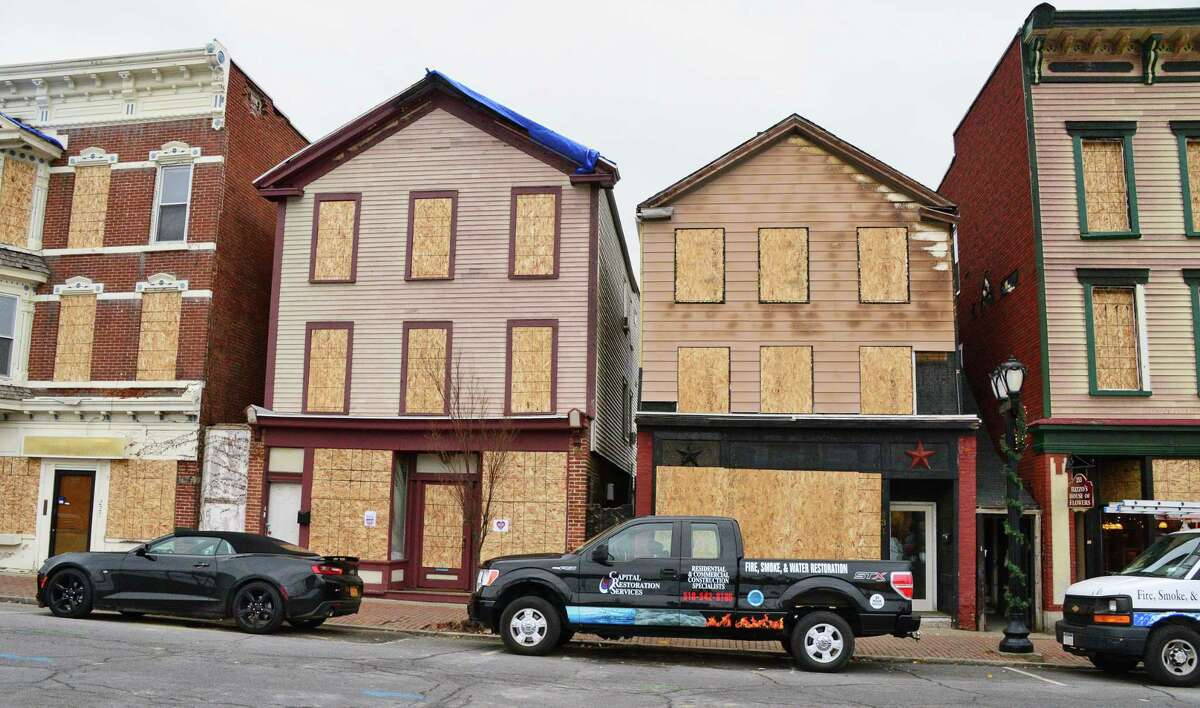 Boarded up buildings damaged from last week's fire along Remsen Street Tuesday Dec. 6, 2017 in Cohoes, NY. (John Carl D'Annibale / Times Union)