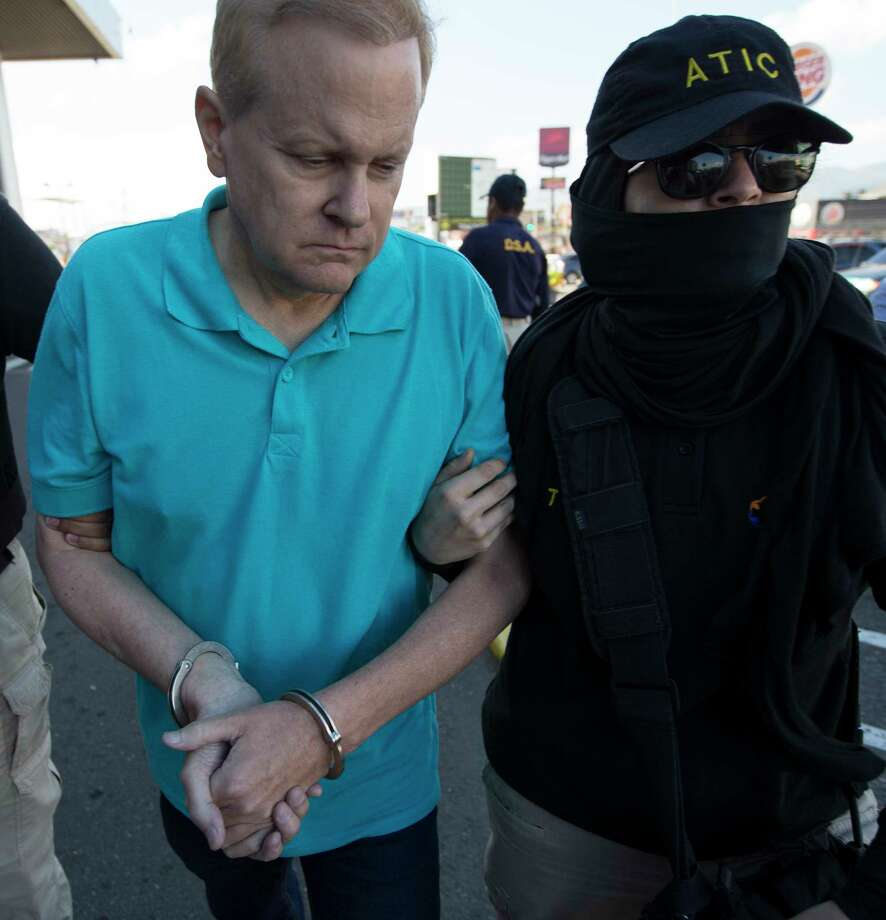 Eric Conn is escorted by SWAT team agents prior to his extradition, at the Toncontin International Airport, in Tegucigalpa, Honduras, Tuesday, Dec. 5, 2017. Conn, a fugitive Kentucky lawyer who escaped before facing sentencing for his central role in a massive Social Security fraud case, was captured as he came out of a restaurant in the coastal city of La Ceiba, on Monday. (AP Photo/Moises Castillo) Photo: Moises Castillo, STF / Copyright 2017 The Associated Press. All rights reserved.